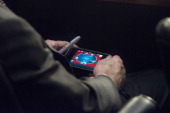 Senator John McCain plays poker on his IPhone during a US Senate Committee on Foreign Relations hearing where Secretary of State John Kerry Secretary...