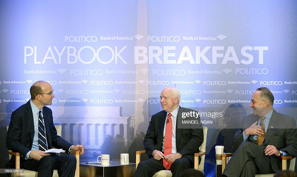 Senator John McCain (C), R-AZ, and Chuck Schumer (R), D-NY, take part in Politico's Playbook Breakfast series with Politico Chief White House Correspondent Mike Allen (L) on January 30, 2013 at the W Hotel in Washington, DC. AFP PHOTO/Mandel NGAN