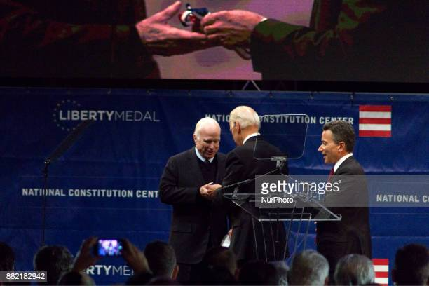 US Senator John McCain receives the 2017 Liberty Medal out of hands of former VP Joe Biden during October 16 2017 a ceremony at the Constitution...
