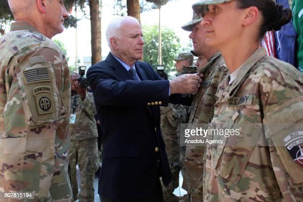 Senator John McCain salute NATO soldiers at ISAF HQ in Kabul Afghanistan on July 4 2017 US Senator John McCain visited the headquarters of NATOled...