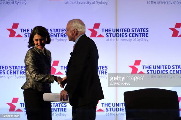 US Senator John McCain shakes hands with New South Wales premier Gladys Berejiklian as he proceeds to address the United States Studies Centre in...