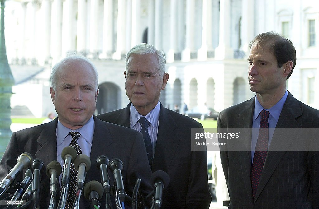 Senator John McCain (R-AZ) spoke at a press conference on Tuesday concerning airline safety while Senator Ernest F. Hollings (D-SC) and Senator Ron Wyden (D-OR) await their turns at the podium at the Senate Swamp on Tuesday.