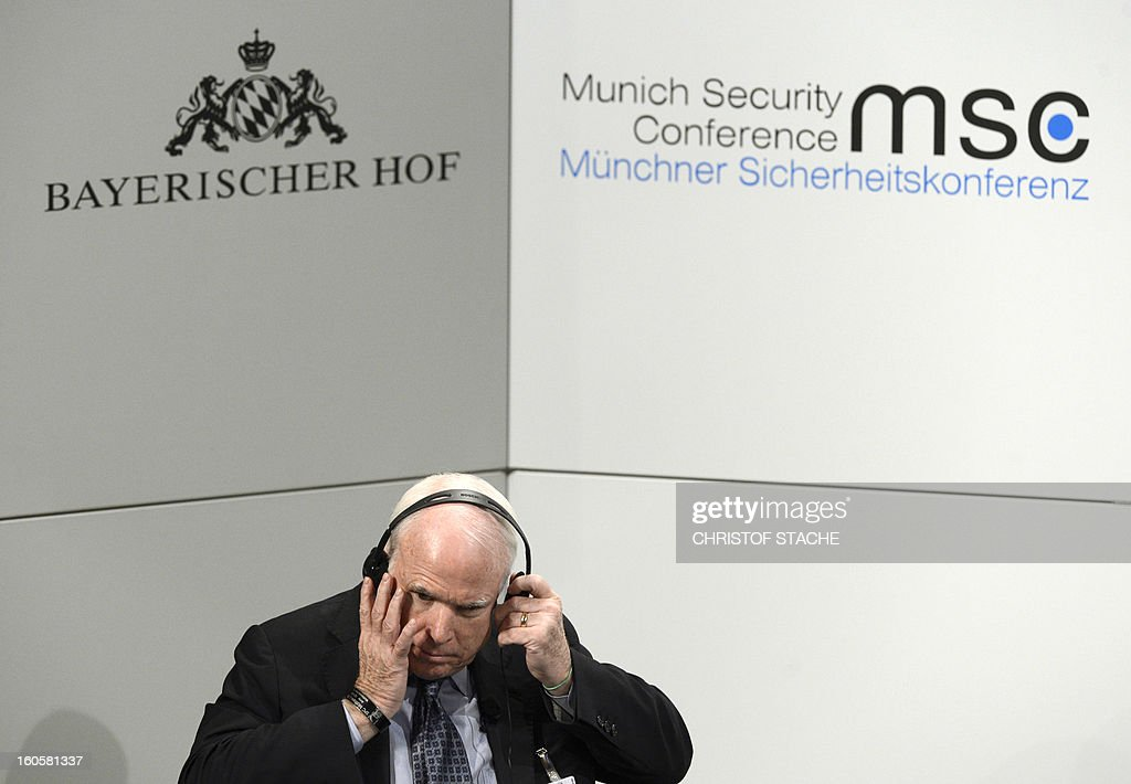 US Senator John McCain takes earphone during a podium discussion on the third day of the 49th Munich Security Conference on February 3, 2013 in Munich, southern Germany as world leaders, ministers and top military gather for talks with the spotlight on Syria, Mali and Iran. AFP PHOTO / CHRISTOF STACHE