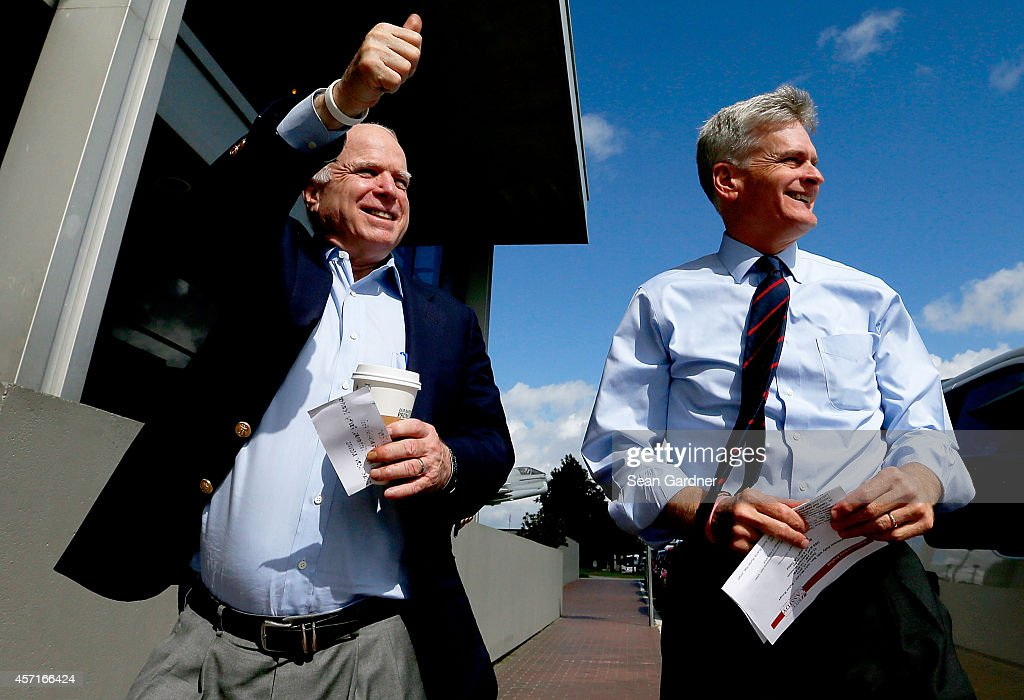 S Senator John McCain waks with US Sen candidate and US Rep Bill Cassidy during a campaign stop at a Veterans rally at the USS Kidd Museum on October...