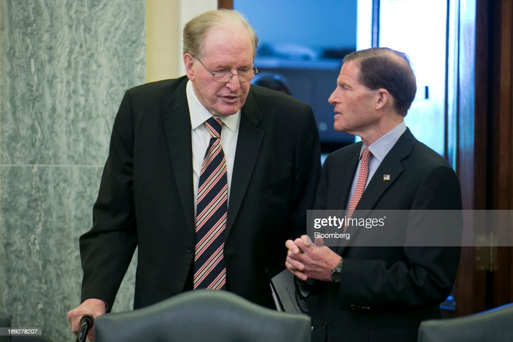 Senator John Rockefeller, a Democrat from West Virginia, left, talks to Senator Richard Blumenthal, a Democrat from Connecticut, prior to a nomination hearing for Anthony Foxx, mayor of Charlotte, North Carolina and U.S. President Barack Obama's nominee as secretary of transportation, not pictured, in Washington, D.C., U.S., on Wednesday, May 22, 2013. President Barack Obama said Charlotte, North Carolina, Mayor Anthony Foxx will press ahead as transportation secretary with the administration's goals to rebuild and expand the nation's infrastructure. Photographer: Andrew Harrer/Bloomberg via Getty Images