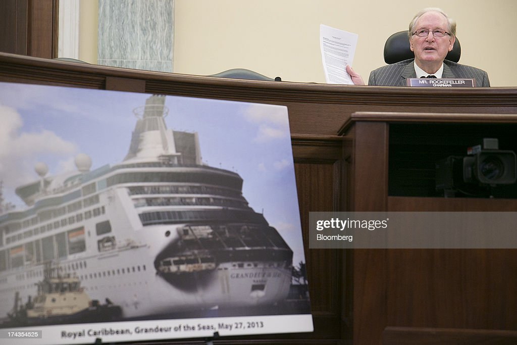Senator John Rockefeller, a Democrat from West Virginia, makes an opening statement behind a photograph of the Royal Caribbean International Grandeur of the Seas cruise ship fire aftermath during a Senate Commerce, Science, and Transportation hearing in Washington, D.C., U.S., on Wednesday, July 24, 2013. Carnival Corp., Royal Caribbean Ltd. and Norwegian Cruise Line Holdings Ltd., the target of proposed legislation after high profile mishaps at sea, will voluntarily publish more data about crimes on their cruises. Photographer: Andrew Harrer/Bloomberg via Getty Images