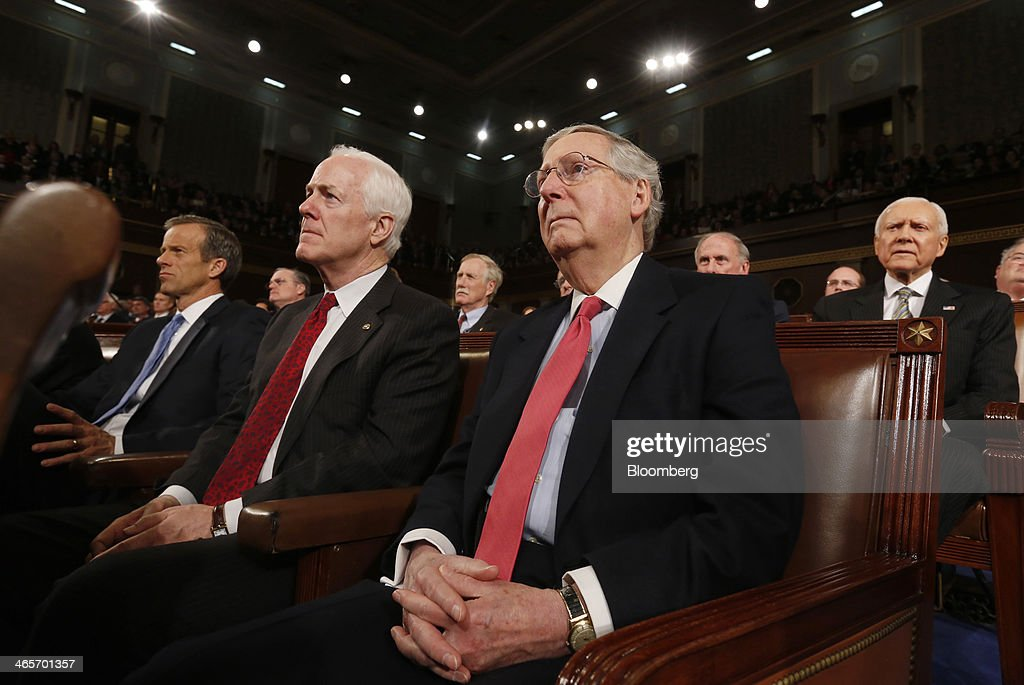 Senator John Thune, a Republican from South Dakota, from left, Senator John Cornyn, a Republican from Texas, Senate Minority Leader Mitch McConnell, a Republican from Kentucky, and Senator Orrin Hatch, a Republican from Utah, listen as U.S. President Barack Obama delivers the State of the Union address to a joint session of Congress at the Capitol in Washington, D.C., U.S., on Tuesday, Jan. 28, 2014. Obama offered modest steps to chip away at the country's economic and social challenges in a State of the Union address that reflects the limits of his power to sway Congress. Photographer: Larry Downing/Pool via Bloomberg