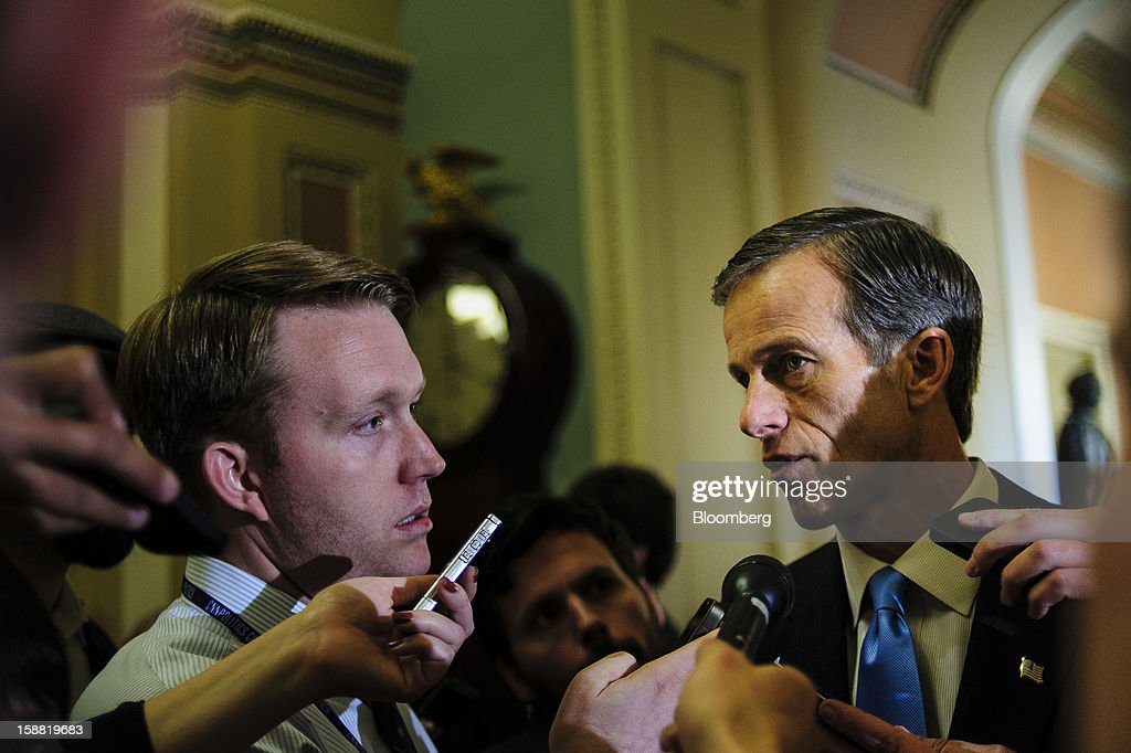 Senator <a gi-track='captionPersonalityLinkClicked' href=/galleries/search?phrase=John+Thune&family=editorial&specificpeople=534356 ng-click='$event.stopPropagation()'>John Thune</a>, a Republican from South Dakota, right, speaks to members of the media following a party caucus meeting at the U.S. Capitol in Washington, D.C., U.S., on Sunday, Dec. 30, 2012. Senate Majority Leader Harry Reid rejected the latest Republican offer to resolve the U.S. fiscal crisis as Minority Leader Mitch McConnell reached out to Vice President Joe Biden in an effort to break the impasse. Photographer: Pete Marovich/Bloomberg via Getty Images