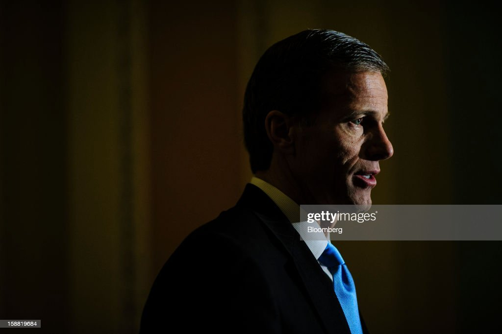 Senator <a gi-track='captionPersonalityLinkClicked' href=/galleries/search?phrase=John+Thune&family=editorial&specificpeople=534356 ng-click='$event.stopPropagation()'>John Thune</a>, a Republican from South Dakota, speaks to a member of the media following a party caucus meeting at the U.S. Capitol in Washington, D.C., U.S., on Sunday, Dec. 30, 2012. Senate Majority Leader Harry Reid rejected the latest Republican offer to resolve the U.S. fiscal crisis as Minority Leader Mitch McConnell reached out to Vice President Joe Biden in an effort to break the impasse. Photographer: Pete Marovich/Bloomberg via Getty Images