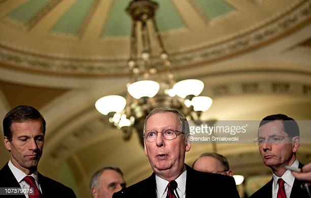 Senator John Thune Senator John Barrasso and others listen as Senate Minority Leader Mitch McConnell speaks to reporters after a caucus luncheon with...