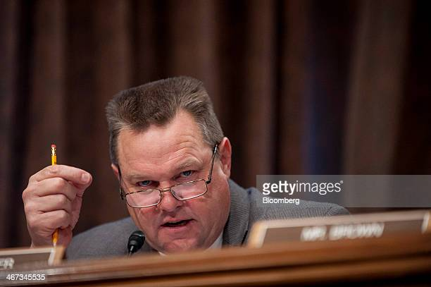 Senator Jon Tester a Democrat from Montana questions witnesses during a Senate Banking Committee hearing in Washington DC US on Thursday Feb 6 2014...