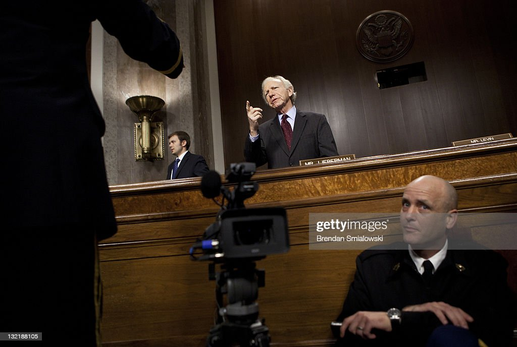 Senator Joseph Lieberman talks to a witness before a hearing of the Senate Armed Services Hearing on Capitol Hill November 10 2011 in Washington DC...