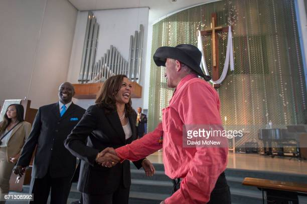 S Senator Kamala D Harris greets people during a town hall at Holman United Methodist Church on April 21 2017 in Los Angeles California A diverse...