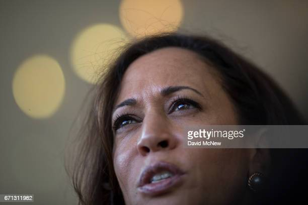 S Senator Kamala D Harris talks to a reporter during a town hall at Holman United Methodist Church on April 21 2017 in Los Angeles California A...