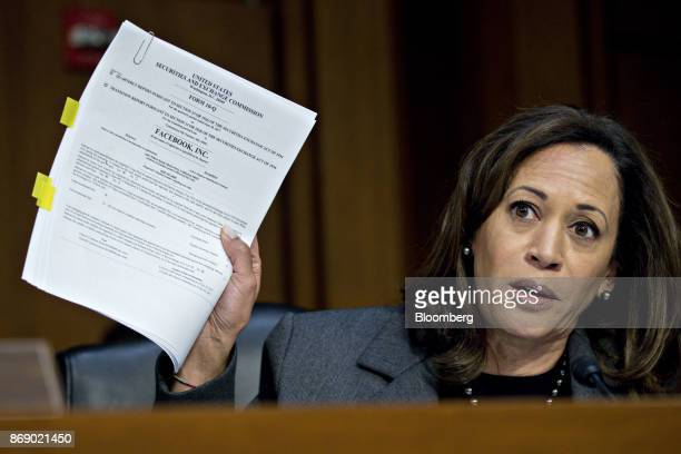 Senator Kamala Harris a Democrat from California holds up a Securities and Exchange Commission 10Q form for Facebook Inc while questioning witnesses...