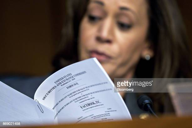 Senator Kamala Harris a Democrat from California reads a Securities and Exchange Commission 10Q form for Facebook Inc while questioning witnesses...