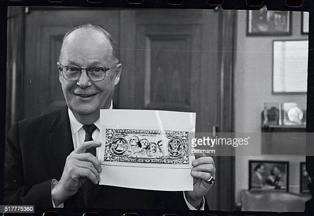 Senator Karl B Mundt RepublicanSouth Dakota holds up an illustration of a new design for a onedollar bill January 18th Senator Mundt introduced in...