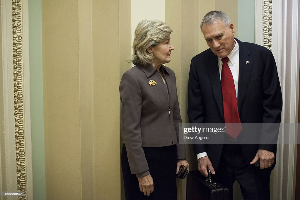 Senator Kay Bailey Hutchison (R-TX) and Senate Minority Whip Jon Kyl (R-AZ) talk outside of Kyl's office on Capitol Hill December 31, 2012 in Washington, DC. The House and Senate are both still in session on New Year's Eve to try to deal with the looming 'fiscal cliff.'