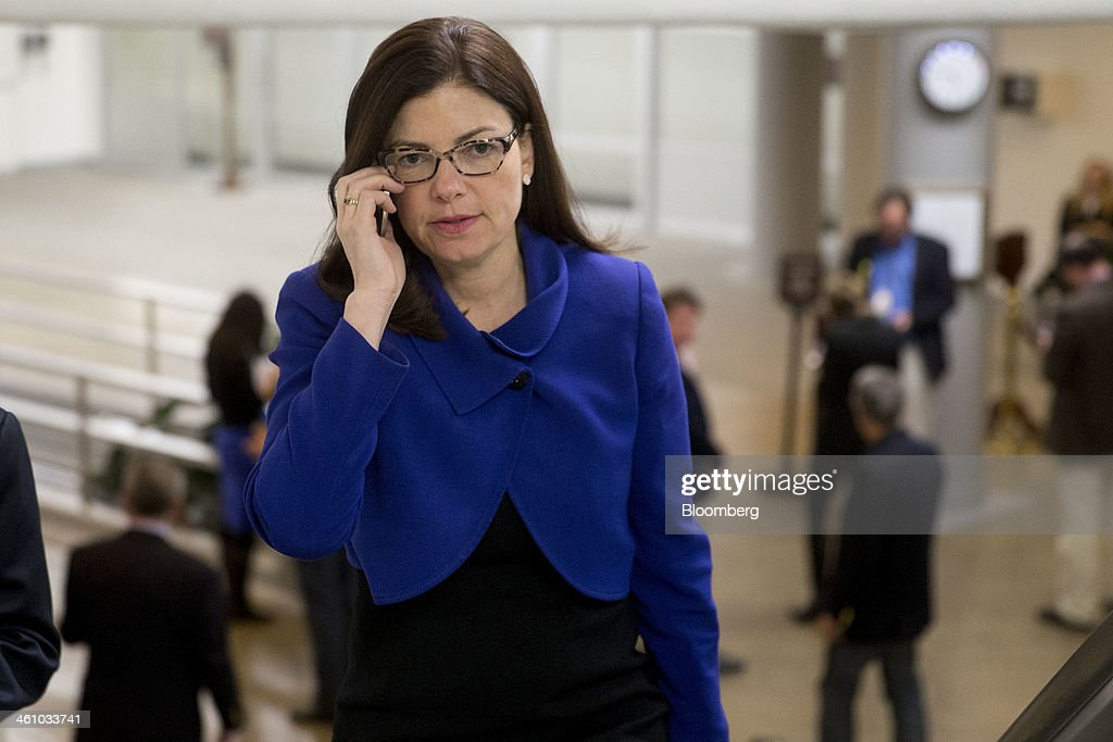 Senator Kelly Ayotte, a Republican from New Hampshire, uses a mobile phone as she arrives to the U.S. Capitol to vote on the nomination of Janet Yellen as chairman of the U.S. Federal Reserve in Washington, D.C., U.S., on Monday, Jan. 6, 2014. Yellen, currently Fed vice chairman, won U.S. Senate confirmation to become the 15th chairman of the Federal Reserve and the first woman to head the central bank in its 100-year history. Photographer: Andrew Harrer/Bloomberg via Getty Images
