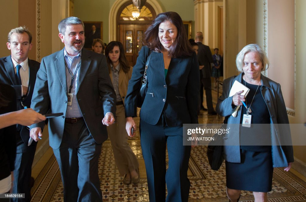US Senator Kelly Ayotte (C), R-New Hampshire, walks through the hall on Capitol Hill in Washington, DC, October 14, 2013. Rival Republican and Democratic Senate leaders Monday said they were optimistic they could agree a deal to stave off a debt default that would shred US credibility and rock the global economy. AFP PHOTO / Jim WATSON