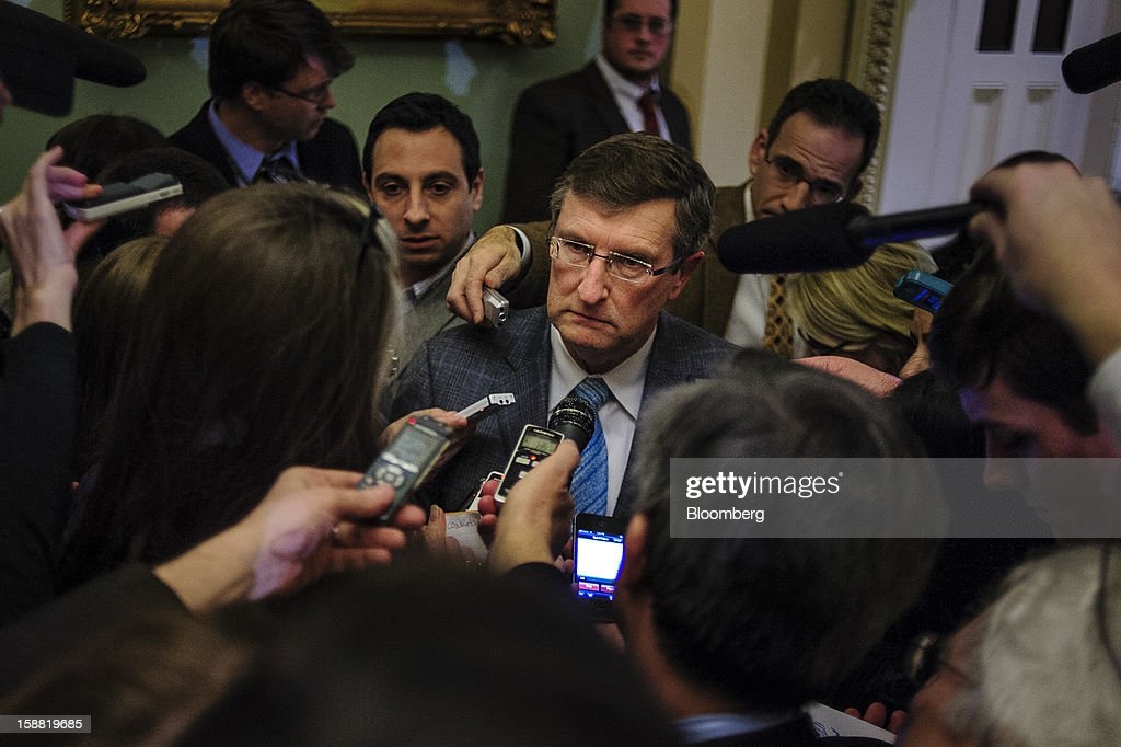 Senator Kent Conrad, a Democrat from North Dakota, speaks to members of the media following a party caucus meeting at the U.S. Capitol in Washington, D.C., U.S., on Sunday, Dec. 30, 2012. Senate Majority Leader Harry Reid rejected the latest Republican offer to resolve the U.S. fiscal crisis as Minority Leader Mitch McConnell reached out to Vice President Joe Biden in an effort to break the impasse. Photographer: Pete Marovich/Bloomberg via Getty Images