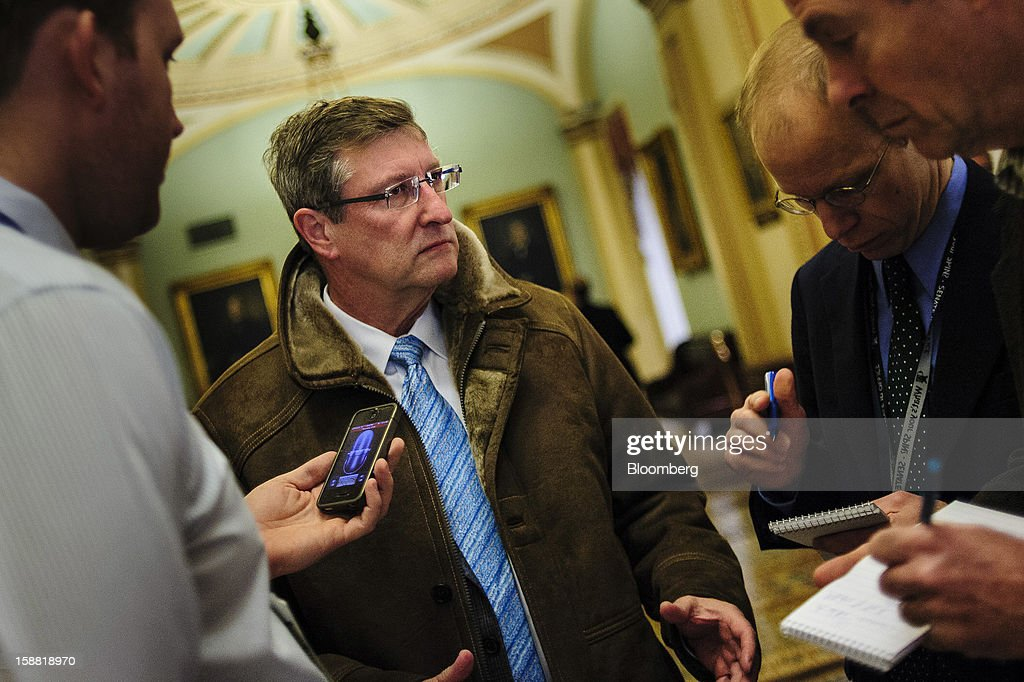 Senator <a gi-track='captionPersonalityLinkClicked' href=/galleries/search?phrase=Kent+Conrad&family=editorial&specificpeople=654003 ng-click='$event.stopPropagation()'>Kent Conrad</a>, a Democrat from North Dakota, speaks with members of the media outside of the Senate Chamber at the U.S. Capitol in Washington, D.C., U.S., on Sunday, Dec. 30, 2012. Senate Majority Leader Harry Reid rejected the latest Republican offer to resolve the U.S. fiscal crisis as Minority Leader Mitch McConnell reached out to Vice President Joe Biden in an effort to break the impasse. Photographer: Pete Marovich/Bloomberg via Getty Images
