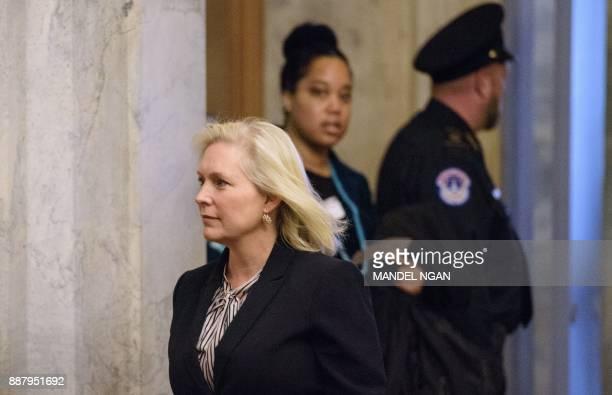 Senator Kirsten Gillibrand DNY arrives at the US Capitol on December 7 2017 in Washington DC / AFP PHOTO / MANDEL NGAN