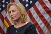 Senator Kirsten Gillibrand DNY listens to a speaker during a press conference to announce a new medical marijuana bill at the US Capitol on March 10...