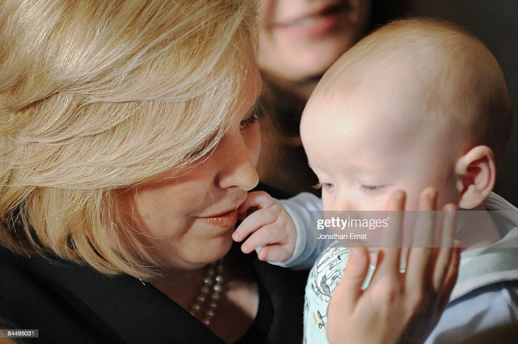 U.S. Senator <a gi-track='captionPersonalityLinkClicked' href=/galleries/search?phrase=Kirsten+Gillibrand&family=editorial&specificpeople=4099377 ng-click='$event.stopPropagation()'>Kirsten Gillibrand</a> (D-NY) (L) holds her son Henry after her swearing-in to at the US Capitol on January 27, 2009 in Washington, DC. Gillibrand was selected by New York Gov. David Paterson to fill the seat vacated by Hillary Clinton when she became U.S. Secretary of State.