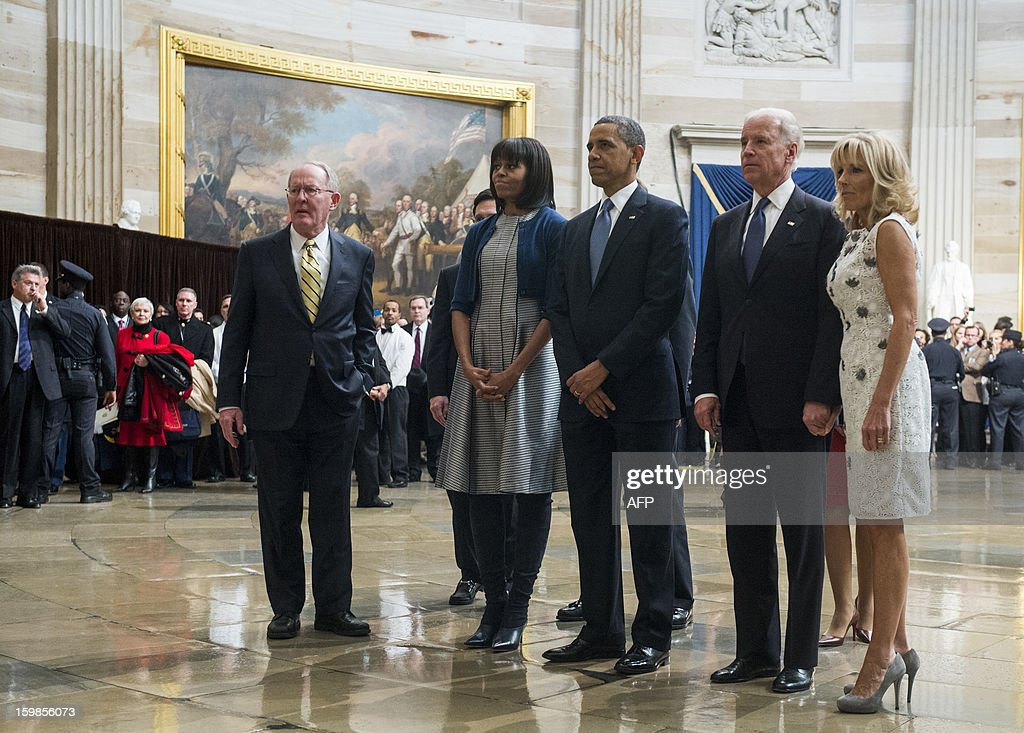 US Senator Lamar Alexander (R-Tenn), House Majority Leader Eric Cantor (R-Va), US First lady Michelle Obama, US President Barack Obama, Vice President Joe Biden, Jill Biden pause to pay their respects at the Martin Luther King, Jr. statue in the Capitol rotunda as they leave the 2013 Inaugural Luncheon following President Obama's inauguration on January 21, 2013. AFP PHOTO / POOL / Bill CLARK