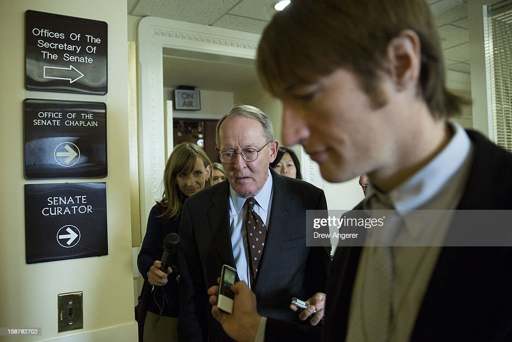 Senator Lamar Alexander (R-TN) leaves a news conference about the 'fiscal cliff' on Capitol Hill December 28, 2012 in Washington, DC. Senators were back on Capitol Hill on Friday to try to deal with the 'fiscal cliff' before the year-end deadline.