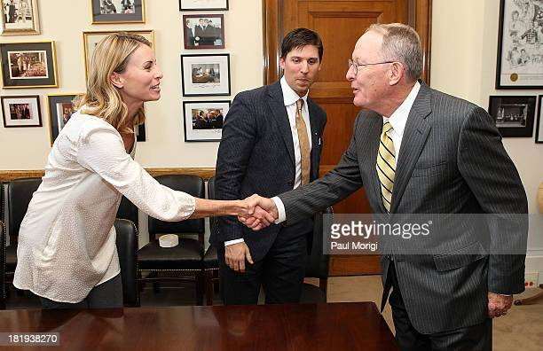 Senator Lamar Alexander right greets super model Niki Taylor and NASCAR driver Denny Hamlin at a meeting to discuss support for maternal and infant...