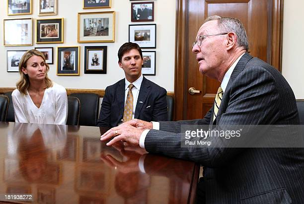 Senator Lamar Alexander right meets with super model Niki Taylor left and NASCAR driver Denny Hamlin to discuss support for maternal and infant...