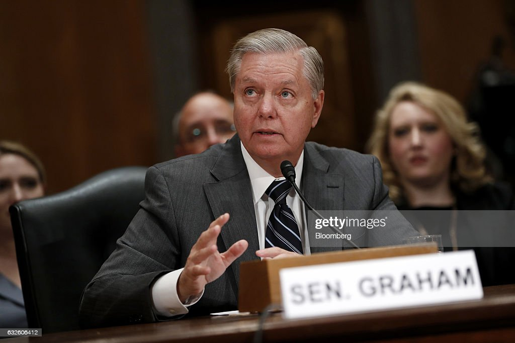 Senator Lindsey Graham, a Republican from South Carolina, introduces Representative Mick Mulvaney, a Republican from South Carolina and Office of Management and Budget director nominee for U.S. President Donald Trump, not pictured, during a Senate Governmental Affairs Committee confirmation hearing in Washington, D.C., U.S., on Tuesday, Jan. 24, 2017. Mulvaney said Tuesday the nearly $20 trillion national debt needs to be 'addressed sooner rather than later' and that he would push Trump to break his campaign promises and cut Social Security and Medicare. Photographer: Aaron P. Bernstein/Bloomberg via Getty Images
