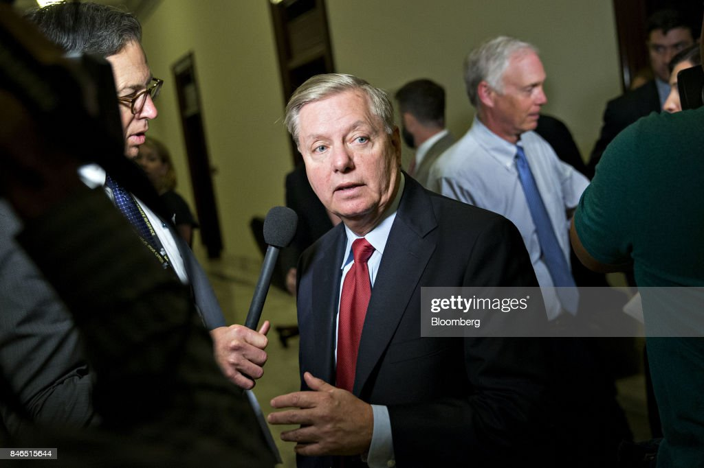 Senator Lindsey Graham, a Republican from South Carolina, walks away after a television interview following a news conference to reform health care on Capitol Hill in Washington, D.C., U.S., on Wednesday, Sept. 13, 2017. The Graham-Cassidy-Heller-Johnson (GCHJ) proposal repeals the structure of Obamacare and replaces it with a block grant given annually to states to help individuals pay for health care. Photographer: Andrew Harrer/Bloomberg via Getty Images