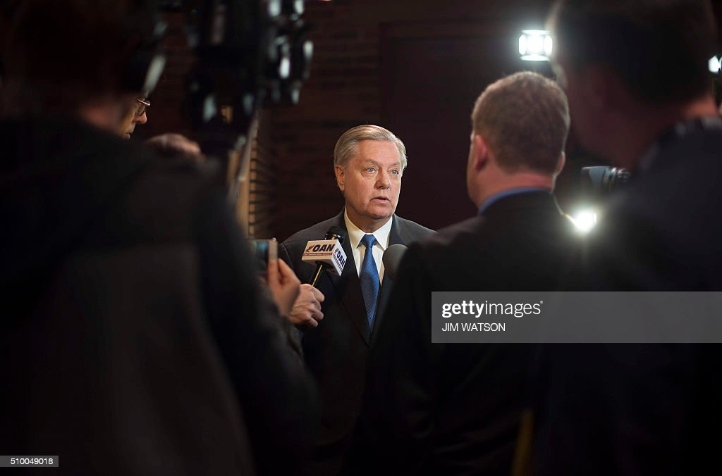 US Senator Lindsey Graham, R-SC, speaks with reporters in the Spin Room prior to the CBS News Republican Presidential Debate in Greenville, South Carolina, February 13, 2016. Republican presidential hopefuls face off in their ninth debate, held in South Carolina which hosts its primary on February 20th. / AFP / JIM WATSON