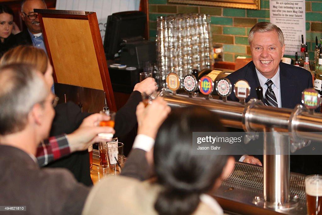 Senator Lindsey Graham serves guests as part of CNN's Politics On Tap at Walnut Brewery on October 27, 2015 in Boulder, Colorado. 25763_001