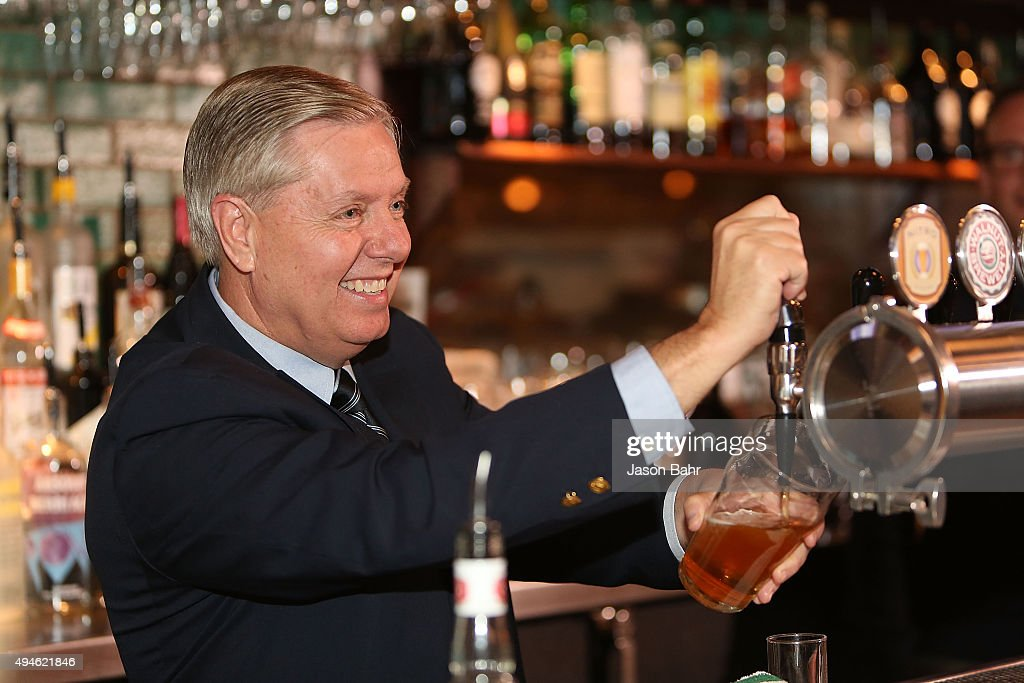 Senator <a gi-track='captionPersonalityLinkClicked' href=/galleries/search?phrase=Lindsey+Graham&family=editorial&specificpeople=240214 ng-click='$event.stopPropagation()'>Lindsey Graham</a> serves guests as part of CNN's Politics On Tap at Walnut Brewery on October 27, 2015 in Boulder, Colorado. 25763_001