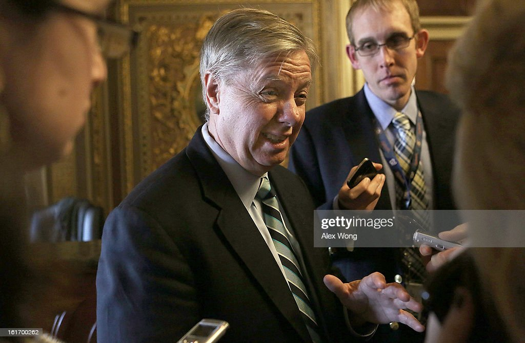U.S. Senator Lindsey Graham (R-SC) speaks to members of the press at the Capitol February 14, 2013 on Capitol Hill in Washington, DC. Senate Republicans have signaled that they will block the confirmation of former Senator Chuck Hagel (R-NE) to become the new Secretary of Defense.
