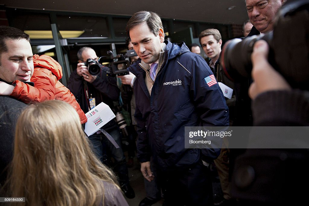 Senator <a gi-track='captionPersonalityLinkClicked' href=/galleries/search?phrase=Marco+Rubio+-+Politician&family=editorial&specificpeople=11395287 ng-click='$event.stopPropagation()'>Marco Rubio</a>, a Republican from Florida and 2016 presidential candidate, center, speaks with residents during a visit to a polling station in Bedford, New Hampshire, U.S., on Tuesday, Feb. 9, 2016. Voters in New Hampshire took to the polls today in the nation's first primary in the U.S. presidential race. Photographer: Daniel Acker/Bloomberg via Getty Images