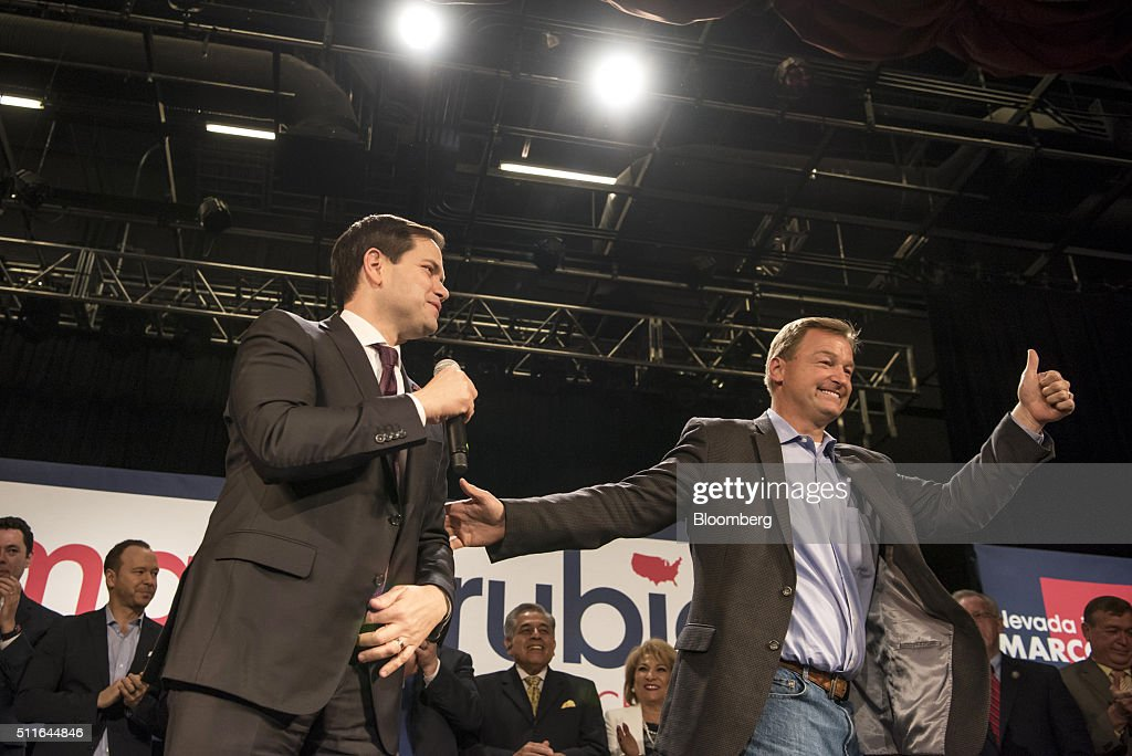 Senator <a gi-track='captionPersonalityLinkClicked' href=/galleries/search?phrase=Marco+Rubio+-+Politician&family=editorial&specificpeople=11395287 ng-click='$event.stopPropagation()'>Marco Rubio</a>, a Republican from Florida and 2016 presidential candidate, left, speaks as Senator <a gi-track='captionPersonalityLinkClicked' href=/galleries/search?phrase=Dean+Heller&family=editorial&specificpeople=3945227 ng-click='$event.stopPropagation()'>Dean Heller</a>, a Republican from Nevada, gives a thumbs up during a campaign event at Texas Station Gambling Hall and Hotel in North Las Vegas, Nevada, U.S., on Sunday, Feb. 21, 2016. Rubio, who placed second in the South Carolina primary, was nearly written off after a bad debate stumble and fifth-place finish in the New Hampshire primary. Photographer: David Paul Morris/Bloomberg via Getty Images