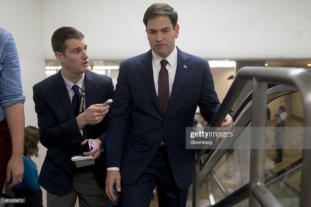 Senator <a gi-track='captionPersonalityLinkClicked' href=/galleries/search?phrase=Marco+Rubio+-+Politician&family=editorial&specificpeople=11395287 ng-click='$event.stopPropagation()'>Marco Rubio</a>, a Republican from Florida, right, speaks to a reporter as he arrives to the U.S. Capitol to vote on the nomination of Janet Yellen as chairman of the U.S. Federal Reserve in Washington, D.C., U.S., on Monday, Jan. 6, 2014. Yellen, currently Fed vice chairman, won U.S. Senate confirmation to become the 15th chairman of the Federal Reserve and the first woman to head the central bank in its 100-year history. Photographer: Andrew Harrer/Bloomberg via Getty Images