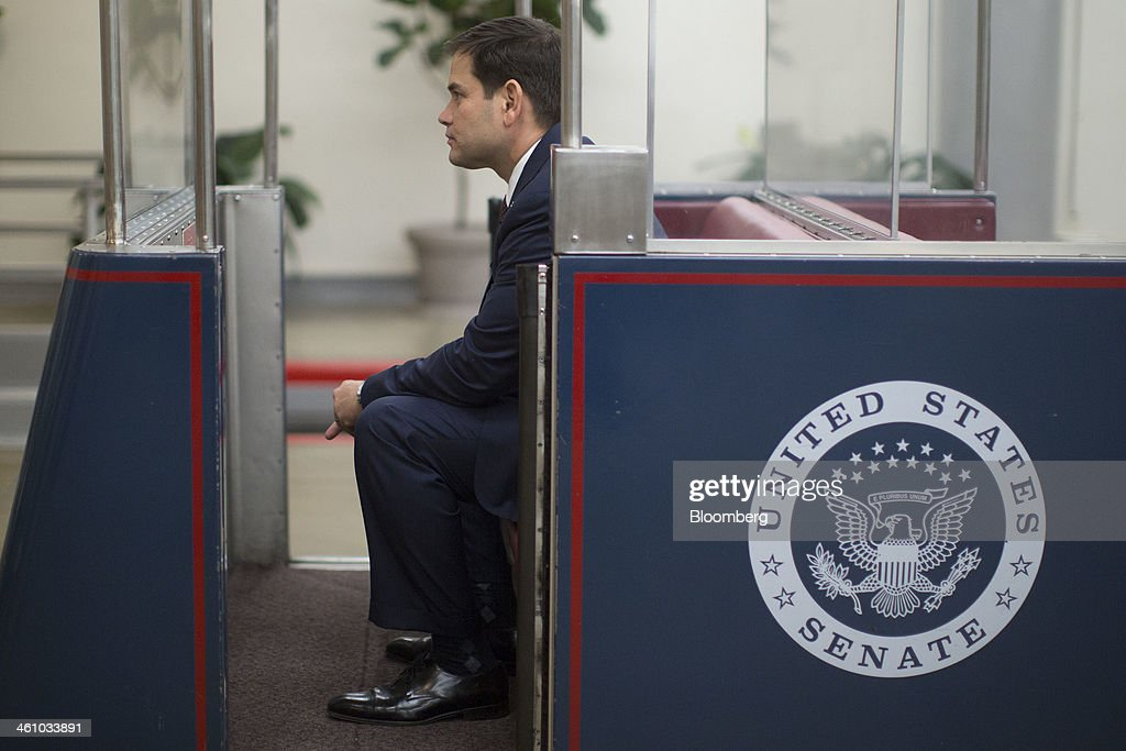 Senator <a gi-track='captionPersonalityLinkClicked' href=/galleries/search?phrase=Marco+Rubio+-+Politician&family=editorial&specificpeople=11395287 ng-click='$event.stopPropagation()'>Marco Rubio</a>, a Republican from Florida, sits on the Senate subway after voting on the nomination of Janet Yellen as chairman of the U.S. Federal Reserve in Washington, D.C., U.S., on Monday, Jan. 6, 2014. Yellen, currently Fed vice chairman, won U.S. Senate confirmation to become the 15th chairman of the Federal Reserve and the first woman to head the central bank in its 100-year history. Photographer: Andrew Harrer/Bloomberg via Getty Images