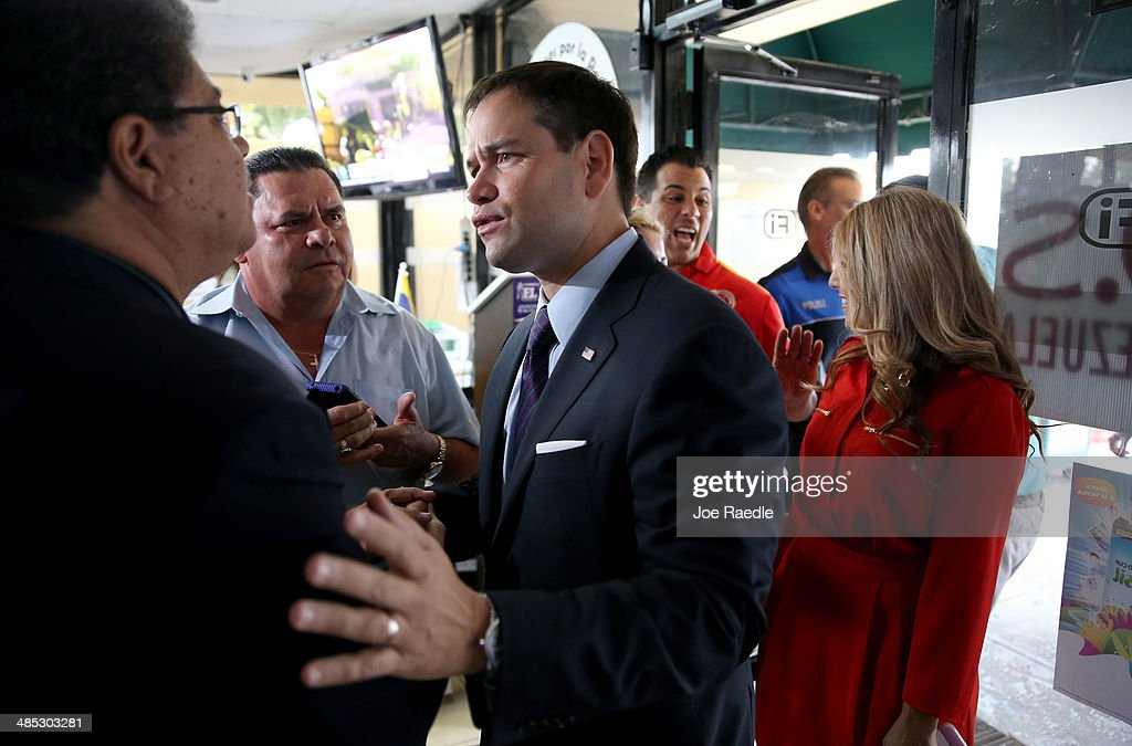 U.S. Senator <a gi-track='captionPersonalityLinkClicked' href=/galleries/search?phrase=Marco+Rubio+-+Politician&family=editorial&specificpeople=11395287 ng-click='$event.stopPropagation()'>Marco Rubio</a> (R-FL) interacts with people at an event to show support for the Venezuelan community at the El Arepazo 2 Restaurant on April 17, 2014 in Doral, Florida. Rubio and Senator Bill Nelson (D-FL) spoke about the need for the United States to support the opposition in Venezuela against Venezuelan President Nicolas Maduro.