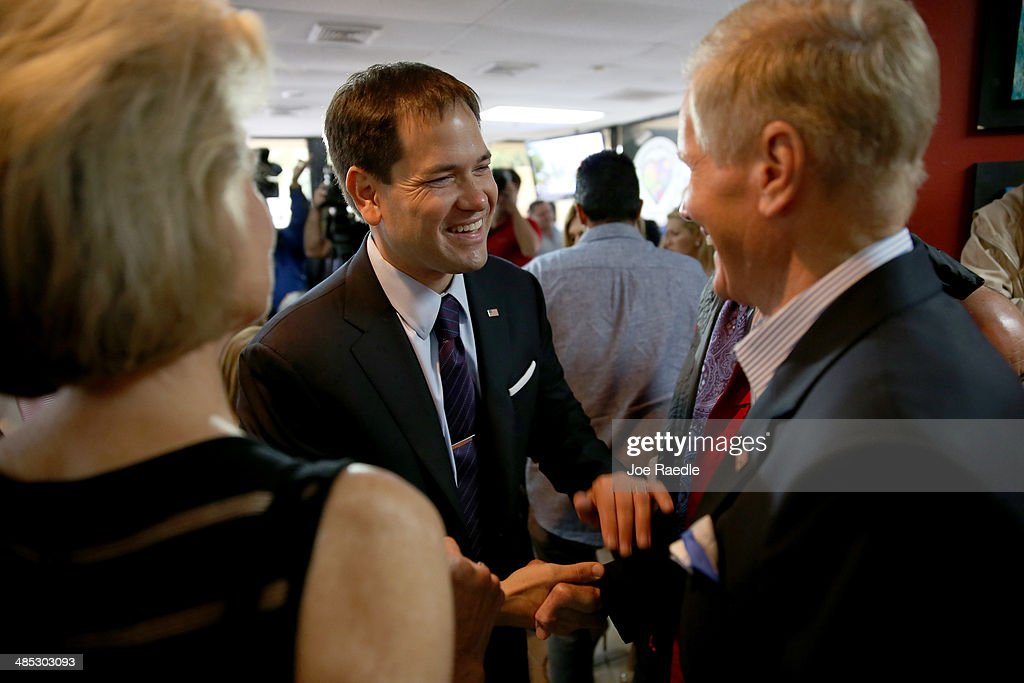U.S. Senator <a gi-track='captionPersonalityLinkClicked' href=/galleries/search?phrase=Marco+Rubio+-+Politician&family=editorial&specificpeople=11395287 ng-click='$event.stopPropagation()'>Marco Rubio</a> (R-FL) (C) shakes hands with Sen. <a gi-track='captionPersonalityLinkClicked' href=/galleries/search?phrase=Bill+Nelson+-+Florida+Senator&family=editorial&specificpeople=13672972 ng-click='$event.stopPropagation()'>Bill Nelson</a> (D-FL) before holding a press conference to show support for the Venezuelan community at the El Arepazo 2 Restaurant on April 17, 2014 in Doral, Florida. The Senators spoke about the need for the United States to support the opposition in Venezuela against Venezuelan President Nicolas Maduro.