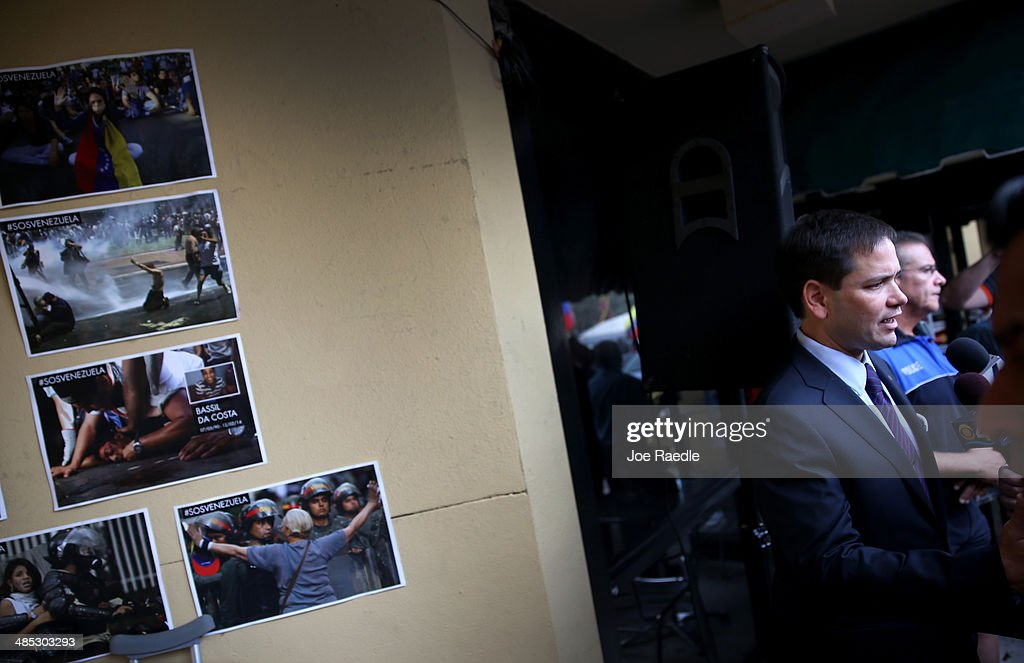 U.S. Senator Marco Rubio (R-FL) speaks to the media next to a wall dedicated to the victims of the violence in Venezuela as he shows support for the Venezuelan community at the El Arepazo 2 Restaurant on April 17, 2014 in Doral, Florida. Rubio and Senator Bill Nelson (D-FL) spoke about the need for the United States to support the opposition in Venezuela against Venezuelan President Nicolas Maduro.