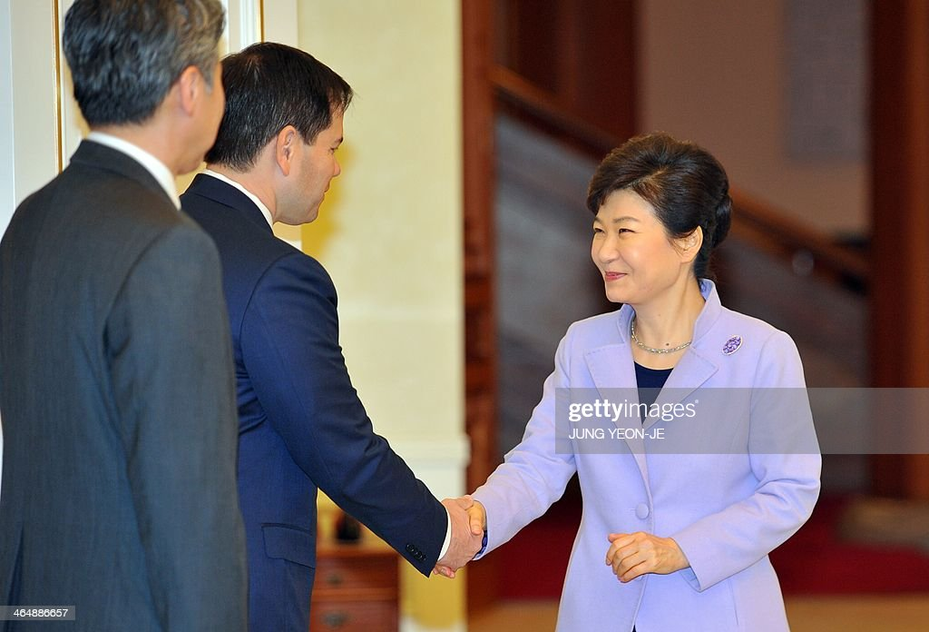 US Senator Marco Rubio (2nd L), the ranking member of the Senate Foreign Relations Committee's East Asian and Pacific Affairs Subcommittee, shakes hands with South Korean President Park Geun-Hye (R) during their meeting at the presidential Blue House in Seoul on January 25, 2014.