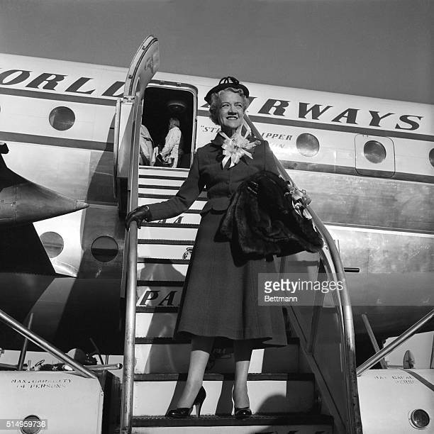 Senator Margaret Chase Smith says farewell at Idlewild Airport as she boards a plane for London on the first leg of her two part aroundtheworld...