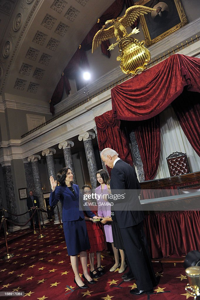 US Senator Maria Cantwell, D-WA, (L) participates in a reenacted swearing-in with his son Robert Menendez and daughter Alicia Jacobsen Menendez and US Vice President Joe Biden in the Old Senate Chamber at the U.S. Capitol January 3, 2013 in Washington, DC. The 113th US Congress, featuring dozens of new faces in the House and Senate, convened Thursday fresh from the year-end 'fiscal cliff' fiasco, as lawmakers cast a wary eye towards the tough budget battles ahead. AFP PHOTO/Jewel Samad
