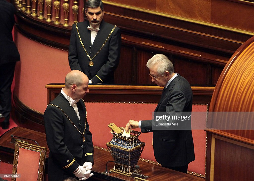 Senator <a gi-track='captionPersonalityLinkClicked' href=/galleries/search?phrase=Mario+Monti&family=editorial&specificpeople=632091 ng-click='$event.stopPropagation()'>Mario Monti</a> votes for the president of Senate during the Italian Parliament inaugural session at Senate on March 15, 2013 in Rome, Italy. The new Italian parliament, which opens the 17th Legislature, has the task of electing the President of the House of Parliament and of the Senate, before giving way to a new government. Pier Luigi Bersani, leader of the Democratic Party, asked his senators and representatives to vote blank votes with the intent to continue to work on an agreement with the Five Stars Movement (M5S) who instead said that it will vote only for its candidates for the presidency of House of Parliament and the Senate.